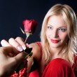 Beautiful Woman holding red rose. — Stock Photo