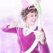 Angel with bow and arrow in pink clouds — Stock Photo