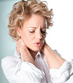 Woman with pain in neck — Stock Photo