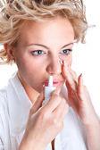 Woman use an bronchial inhale — Stock Photo