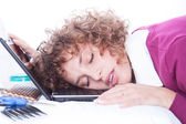 Woman sleeping on laptopat at her working plac — Stock Photo