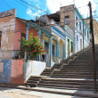 Long Padre Pico street staps with crumbling buildings in Santiago de Cuba - Stock Photo