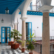 A view of colonial building interior with tropical flowers, Cuba - Stock Photo