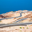 Stock Photo: Dead 's seroad area, curvy highway with desert landscape