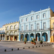 Detail of Old Havana plaza Vieja with colorful tropical buildings - Stock Photo