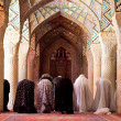 Muslim Friday pray in Prayer Hall of Nasir al-Molk Mosque - Stock Photo