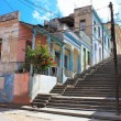 Long Padre Pico street staps with crumbling buildings in Santiago de Cuba — Stock Photo #9177790
