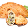 Crispy vegetable Samosa filling with leek, vegetable marrow and mushrooms - Stock Photo