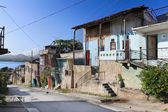 Panoramic view of street with crumbling buildings — Stock Photo