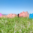 Young couple relaxing on grass in park — Stock Photo