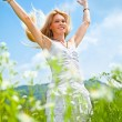 Happy young woman running in the field - Stock Photo