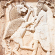 Persian soldier bas-relief killing a bist, stone statue in Shiraz - Stock Photo