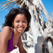 Caribbean woman  on a topical beach - Stock Photo