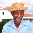 Old cuban man with straw hat make a funny face — Stock Photo