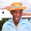 Old cuban man with straw hat make a funny face - Stock Photo