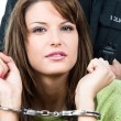 Arrested beautiful woman — Stock Photo #9195808