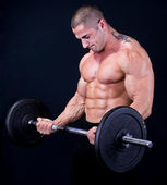 Man with a bar weights — Foto de Stock