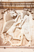 Persian soldier bas-relief killing a bist, stone statue in Shiraz — Stock Photo