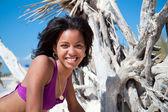 Caribbean woman on a topical beach — ストック写真