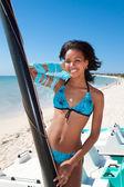 Beautiful caribbean woman on a beach — ストック写真