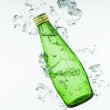 Green Mineral Bottle in the Water — Stock Photo