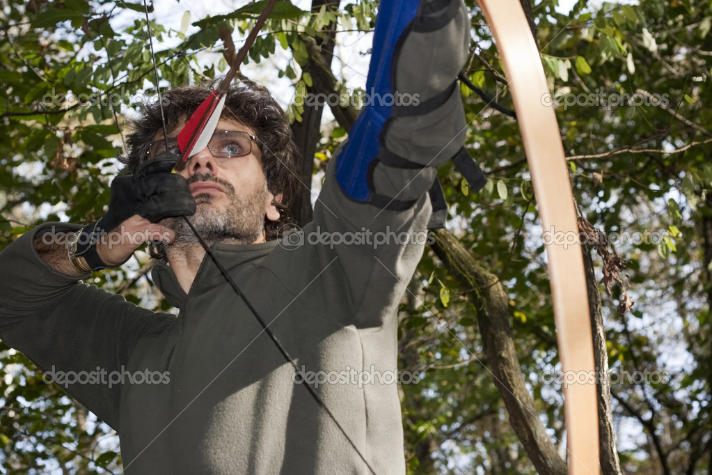 Archer with Longbow in the forest — Stock Photo #8029750