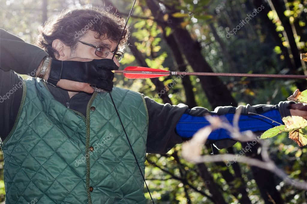 Close up of an archer with a traditional longbow — Stock Photo #8029896