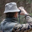 Man checking target before shooting with a technological bow — Stockfoto