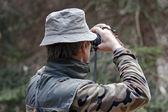 Man checking target before shooting with a technological bow — Stock Photo