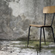 Grunge interior with chair — Foto de Stock