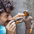 Sculptor working detail — Stockfoto