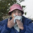 Grandmother with tissue — Stock Photo
