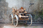 Wheelbarrow with a load of wood — Stock Photo
