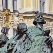 Pigeons on Jan Hus Monument - Stock Photo