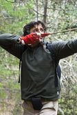 Man Shooting with Historical Bow — Стоковое фото