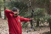 Man aiming with a technological bow — Stock Photo