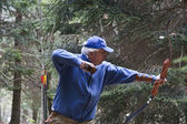 Follow through with a recurve bow — Stock Photo