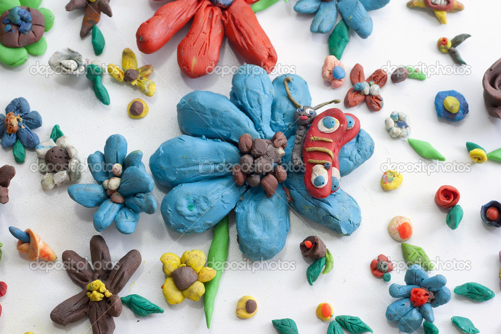 Plasticine colorful flowers with a butterfly, beauty ecological concept — Stock Photo #8165462