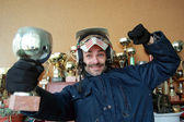Motorcyclist with trophy — Stock Photo