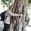 Stock Photo: Mhugging tree