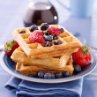 Blueberry waffles with strawberries — Stock Photo #8590632
