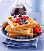 Blueberry waffles with strawberries — Stock Photo
