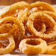 Closeup photo of a pile of onion rings - Stock Photo