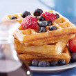 Blueberry waffles with strawberries - Stock Photo