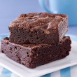 Two brownies stacked on a plate. — Stock Photo #8628296
