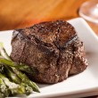 Stock Photo: Seared tenderloin steak with asparagus.