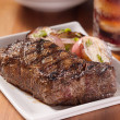 Grilled steak with potatoes and cola in background. — Stock Photo #8628412