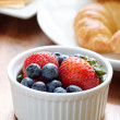 Stock Photo: Breakfast setting with blueberries and strawberries.