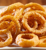 Closeup photo of a pile of onion rings — Stok fotoğraf