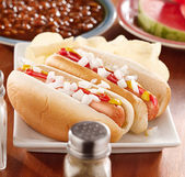 Meal with hotsdogs with toppings — Stock Photo